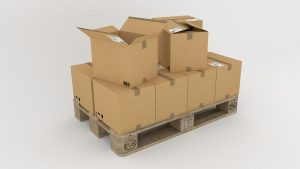 Cardboard boxes on a pallet are a crucial part of corporate packing tips