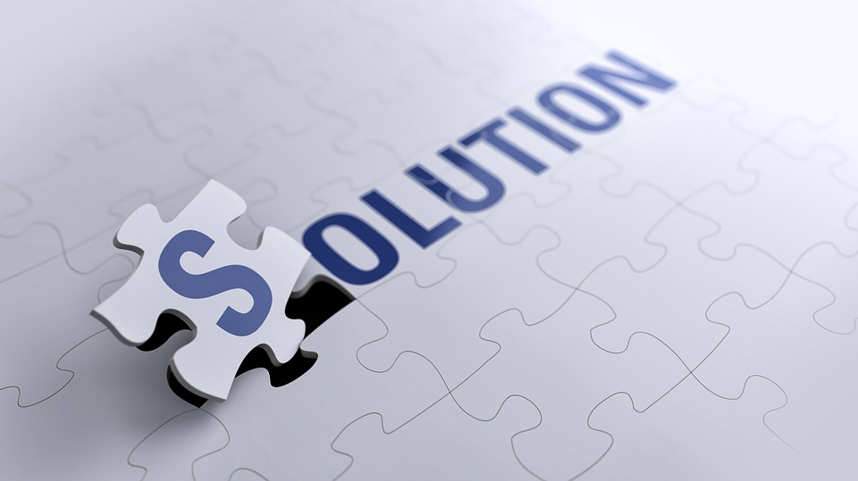 A puzzle that spells the word solution.