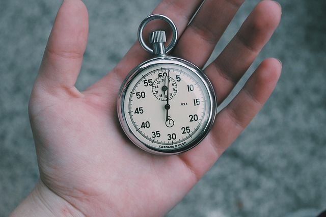 A person holding a stopwatch.