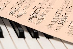 Piano keyboard and a sheet of music.