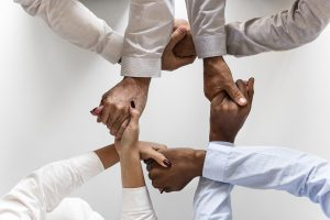 A group of people holding hands.