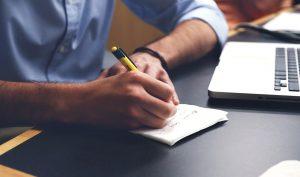 man writing down short term storage tips