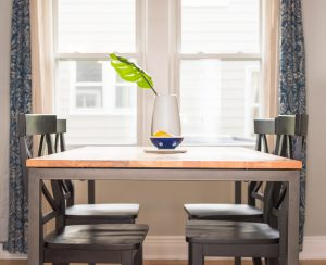 brown dining table and four chairs