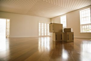 Four boxes in an empty room.