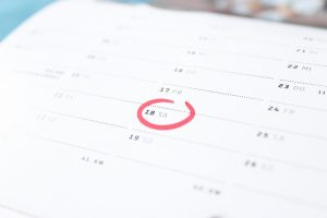 calendar with marked date for organizing a housewarming party