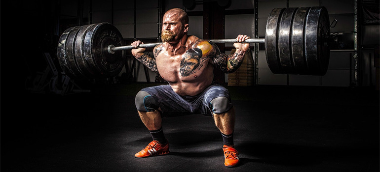 A strongman lifting weights and showing how strong you must be to disassemble and pack a bunk bed