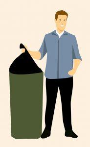 a man throwing away garbage