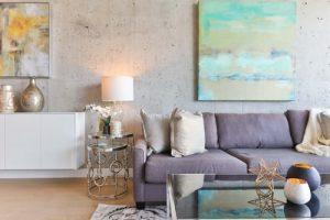 white wooden sideboard beside gray padded sofa