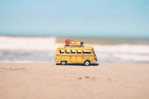 toy moving van on a beach
