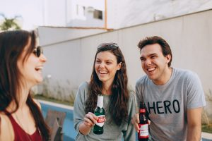 friends drinking beer and laughing