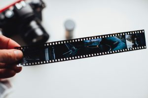 person holding a film roll