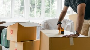 man packing cardboard boxes