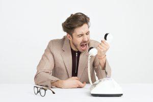 man screaming in the phone