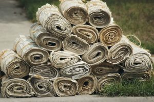 A pile of newspapers on the ground