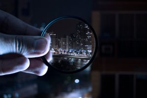 A person holding a magnifying glass