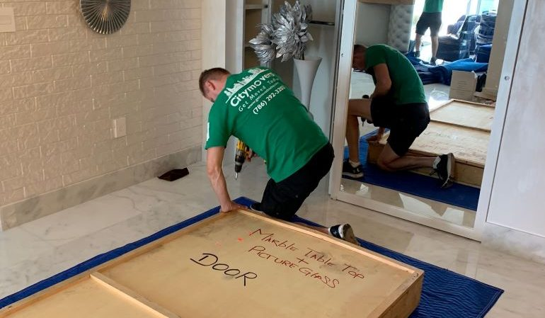 One of our Boca Raton movers, crating a door