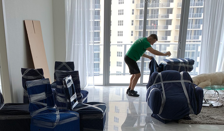 movers in hollywood fl preparing office items for transport.