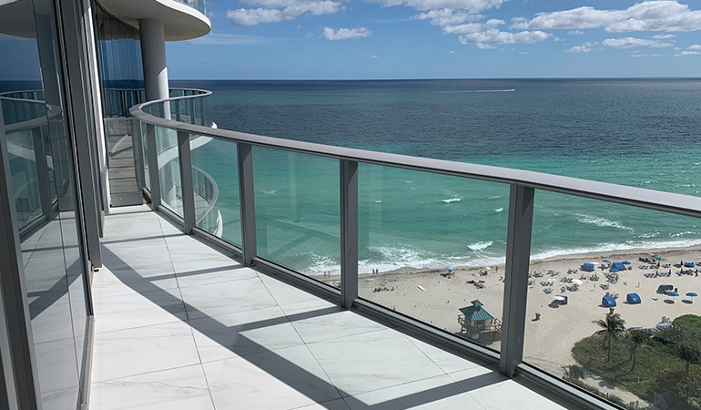 A view from a house on a beautiful beach day.