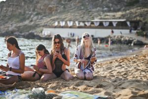 four girls on a sandy beach