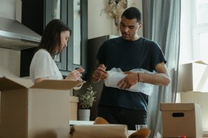 couple packing items for a move