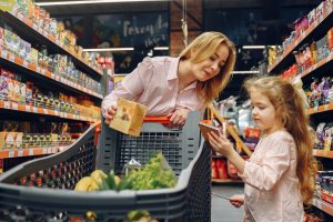 mom and daughter shopping for groceries