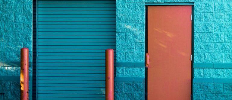 A brown panel door near a storage