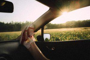 feet on car dashboard