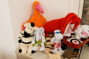 Stuffed animals on a bed