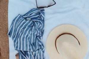 A beach towel and a hat