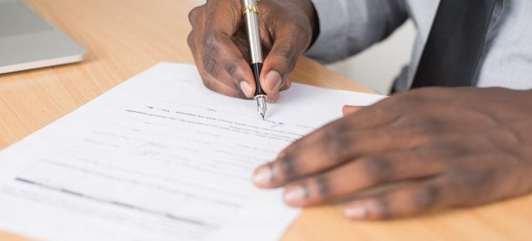 A man signing a mortgage