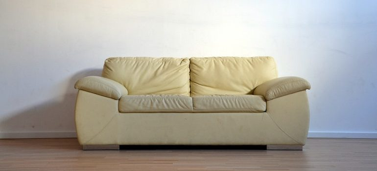 a sofa in an empty room