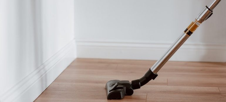 a vacuum cleaning the floor