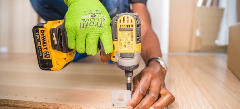 Man with a tool performing Spring renovation tips for Boca Raton