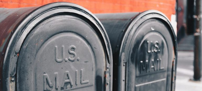 two gray mailboxes