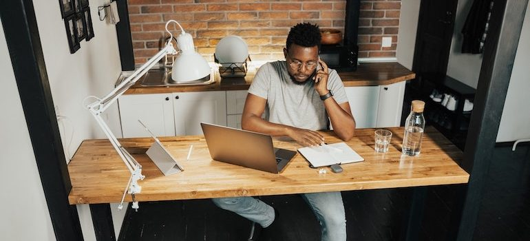 Man working at his desk from home