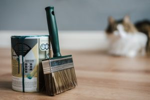paint can with a brush - an example of what will professional movers not move