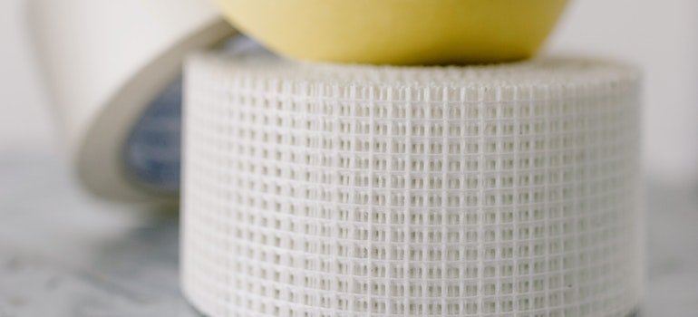masking tapes on table against a white wall
