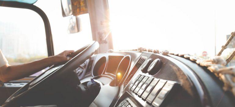 Man behind the steering wheel in a truck