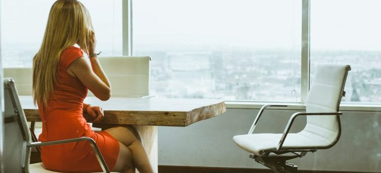 A woman in an office talking on the phone - relocation services Florida