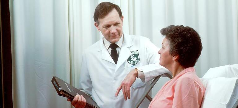 a doctor talking to a woman
