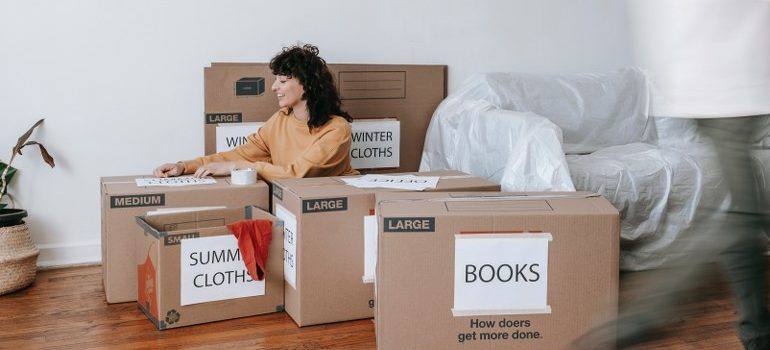 Woman packing for moving from Miami to San Francisco