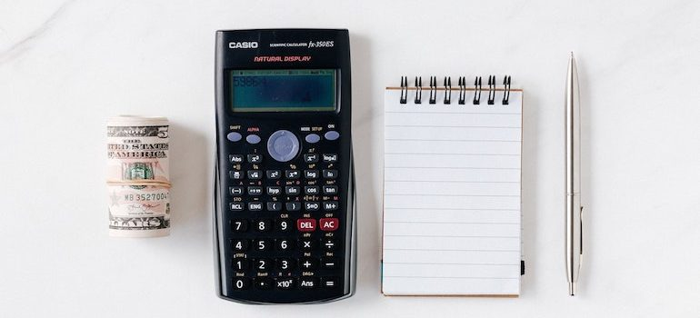 money calculator notepad and pen