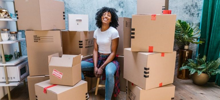 Woman surrounded by boxes