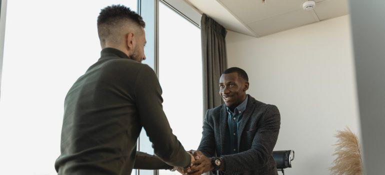 two man handshaking