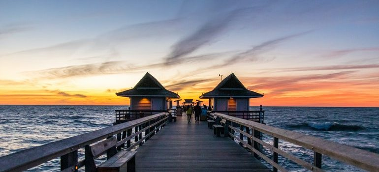 Florida pier at sunset - a place you can be while your South Point movers work.