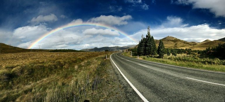 A rainbow at the end of a road