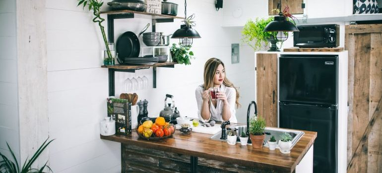 A woman at a kitchen counter