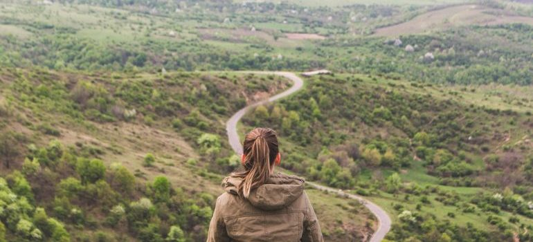 A girl looking at a road - Long distance movers Florida