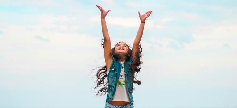 a girl lifting her hands