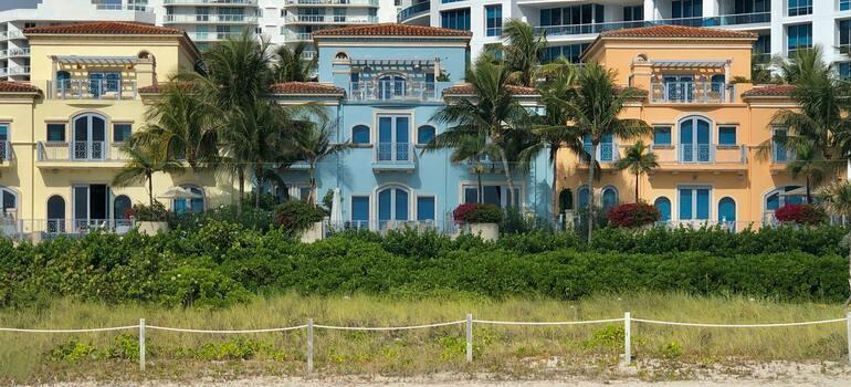 three houses next to the beach